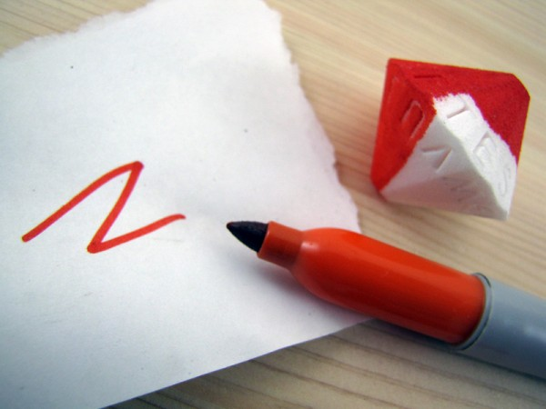 Orange Sharpie, with half-colored Alphabet Die print, and color on white paper.