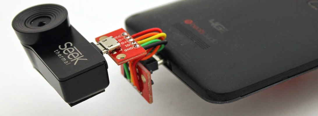 Close shot of bottom rear of HTC DNA smartphone with improvised reversing adapter attached between the phone and a Seek thermal imager add-on.