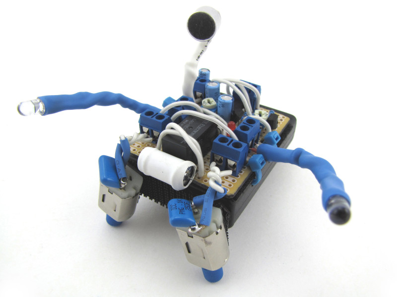 An elaborate but small hand-assembled BEAM style robot with carefullly coordinated colors in blue and white.