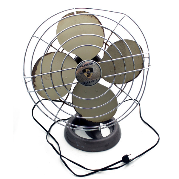 A front view of an all-metal oscillating desk fan with a wire cage. The cage is bent out of shape and the blades show some rust around the edges.